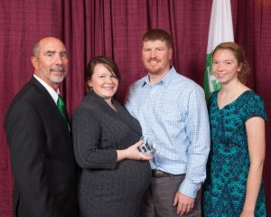 Beth and Mark Heinze accept the 4-H Hall of Fame award on behalf of Dr. Dickson, with Wisconsin 4-H Youth Development Program Director Dale Leidheiser and Wisconsin 4-H Youth Leader Council President Pauline Schlais