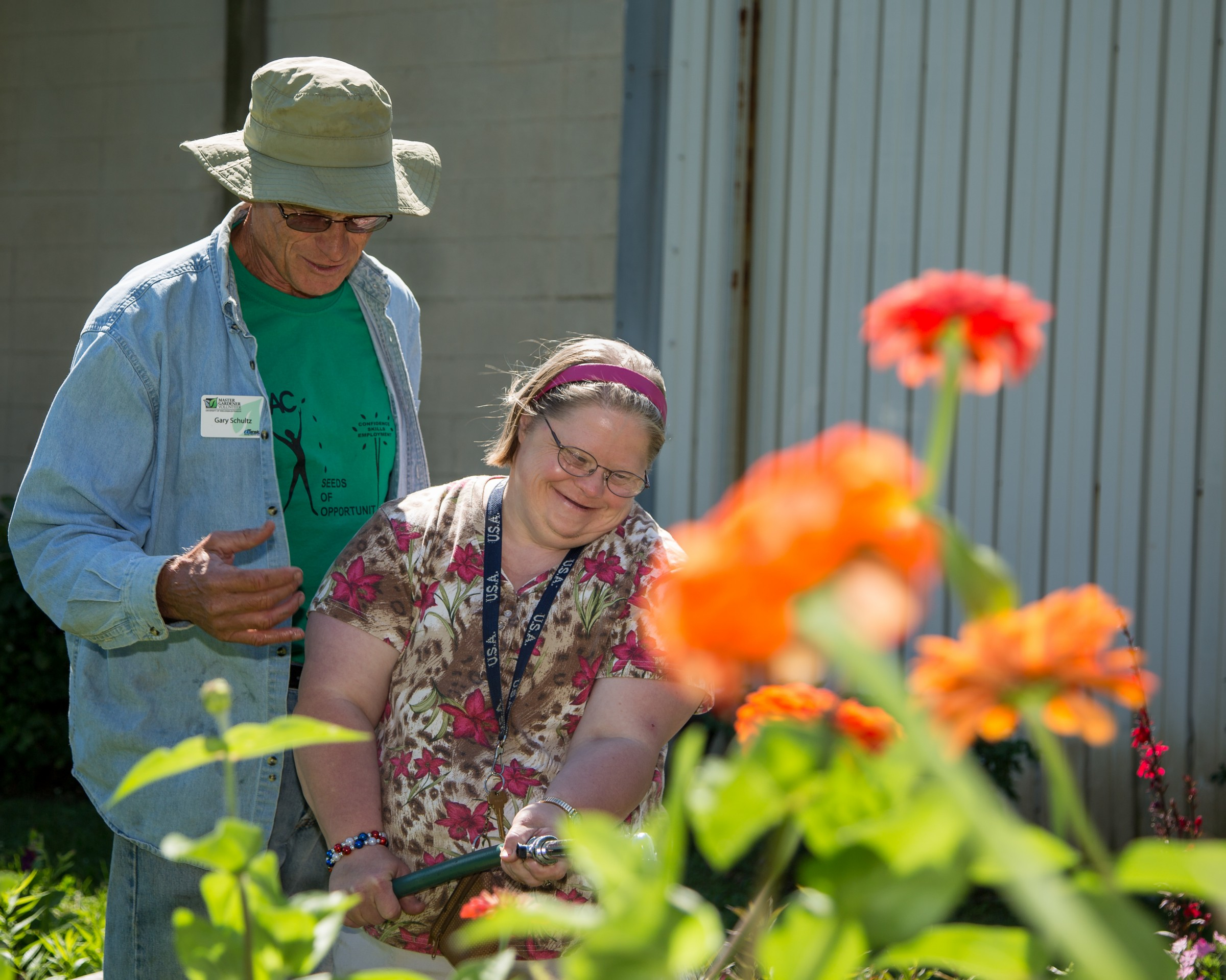 adult with special needs and Master Gardener volunteer