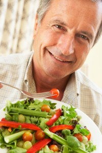 Senior Man Eating A Healthy Salad