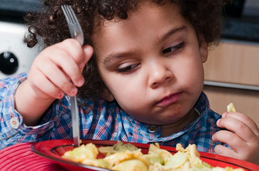 Image of child eating (decor)