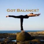Woman balancing atop a rock