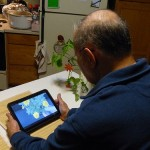 image man watching mobile tablet