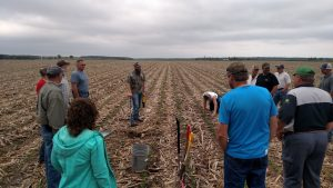 Farmers and NRCS Staff evaluate soil in the field